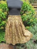1960's Pleated Tricel olive green skirt with dropped yoke.
